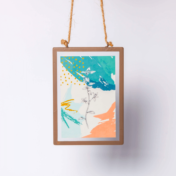 industrial style glass frame with a colourful digital print of oregano
