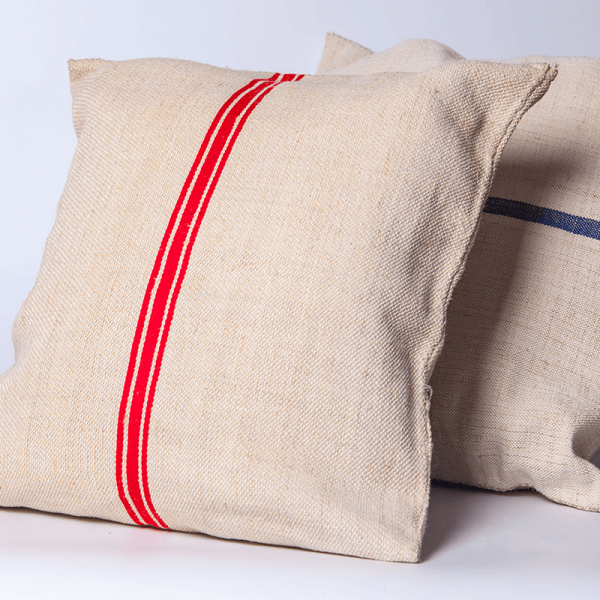 cushions made form old grain sacks with red and blue stripes on them