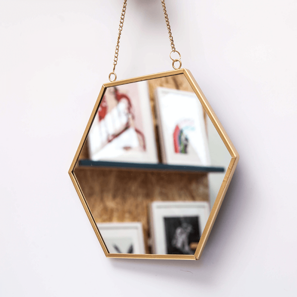 gold hexagonal mirror on a chain